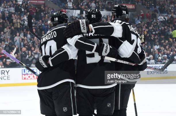 Michael Amadio Austin Wagner and Daniel Brickley of the Los Angeles Kings celebrate Wagner's firstperiod goal against the Winnipeg Jets during the...