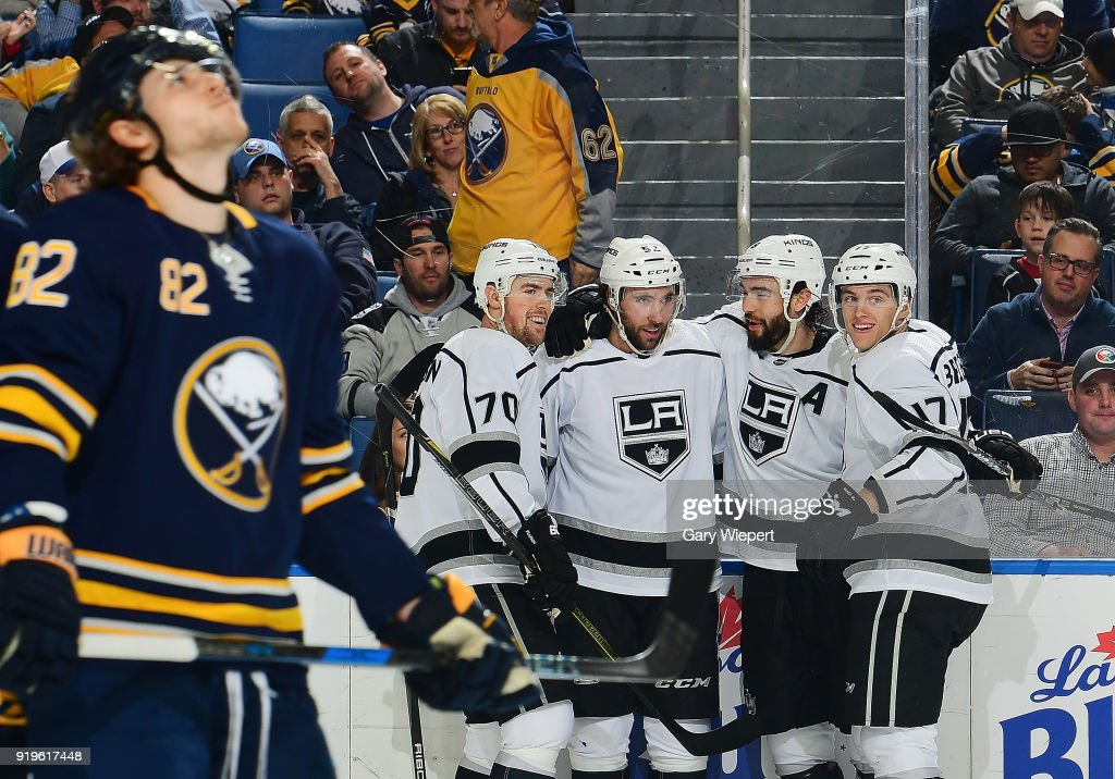 Michael Amadio #52 of the Los Angeles Kings celebrates his goal in the second period with teammates as Nathan Beaulieu #82 of the Buffalo Sabres reacts during an NHL game on February 17, 2018 at KeyBank Center in Buffalo, New York.