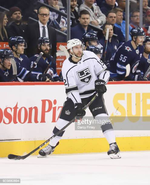 Michael Amadio of the Los Angeles Kings plays the puck along the boards during third period action against the Winnipeg Jets at the Bell MTS Place on...
