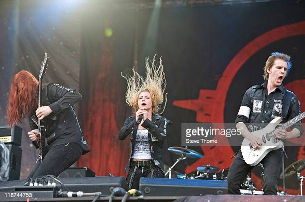 Michael Amott Angela Gossow and Christopher Amott of Arch Enemy perform on stage during the third day of Sonisphere 2011 at Knebworth House on July...