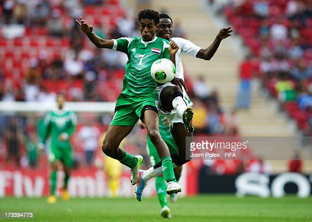 Michael Anaba of Ghana and Jawad Kadhim of Iraq compete for the ball during the FIFA U20 World Cup 3rd Place playoff match between Ghana and Iraq at...