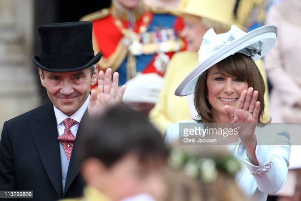 Michael and Carole Middleton smile and wave at the crowds following the marriage of Prince William Duke of Cambridge and Catherine Duchess of...