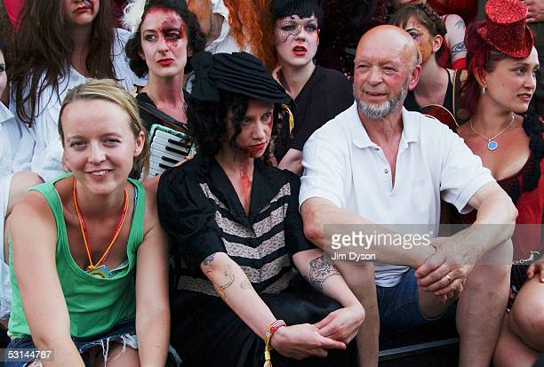 Michael and Emily Eavis pose with the cast of Carnesky's Ghost Train in the Midnight Carnival field of the Glastonbury Music Festival held at Worthy...