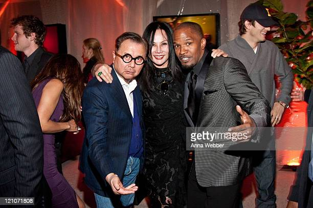Michael and Eva Chow pose with Jamie Foxx attend L'Ermitage on January 29 2010 in Los Angeles California