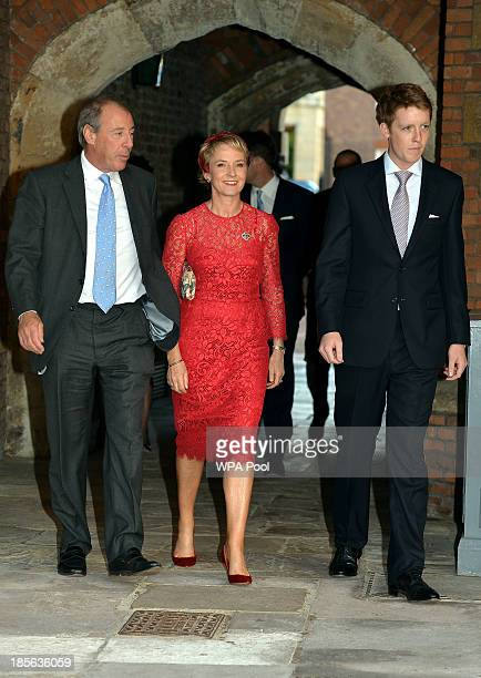 Michael and Julia Samuel arrive with one of Prince George's godparents Hugh Grosvenor at the Chapel Royal in St James's Palace ahead of the...
