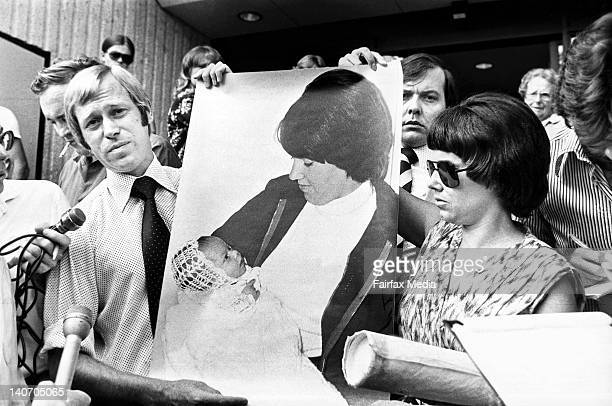 Michael and Lindy Chamberlain hold a photograph of their baby daughter, Azaria Chamberlain, on the steps of the Alice Springs Courthouse following...
