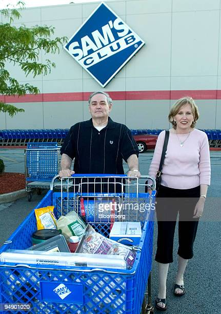 Michael and Penny Bates push their shopping cart to their car after checking out at a Sam's Club store in Tinley Park Illinois on Saturday July 31...