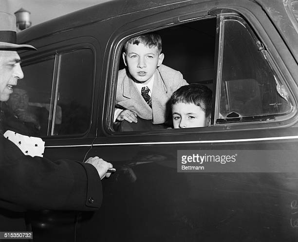 Michael and Robert Rosenberg the two sons of executed spies Julius and Ethel Rosenberg look out from a car