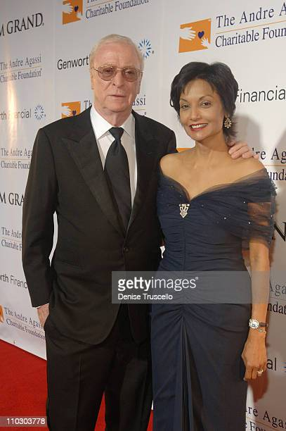 "Michael and Shakira Caine during The Andre Agassi Charitable Foundation's 11th Annual ""Grand Slam for Children"" Fundraiser - Red Carpet at MGM Grand..."