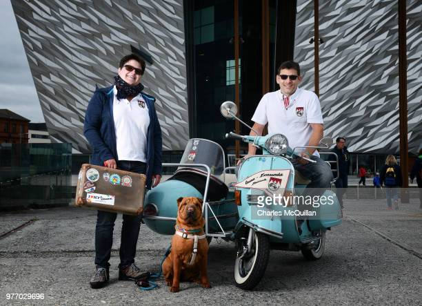 Michael and Silke Auer from Germany and their dog Mia who travels in the sidecar pose with their Vespa Struzzo which won Best of Show as the 2018...