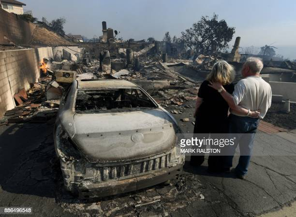 TOPSHOT Michael and Vonea McQuillam stand beside their house that was burnt to the ground during the Thomas wildfire in Ventura California on...