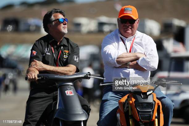 Michael Andretti and Chip Ganassi talk during practice for the NTT IndyCar Series Firestone Grand Prix of Monterey at WeatherTech Raceway Laguna Seca...