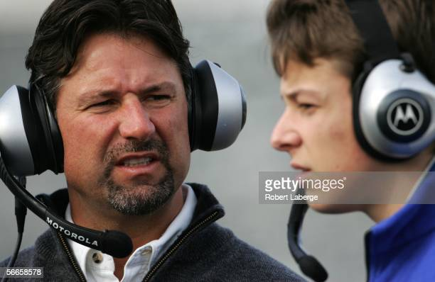 Michael Andretti coowner of Andretti Green Racing with his son Marco Andretti driver of the ArcaEx Andretti Green Racing Dallara Honda during testing...