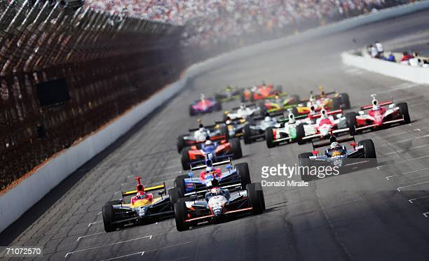 Michael Andretti driver of the Andretti Green Racing Jim Beam/Vonage Dallara Honda leads at the last restart during the IRL IndyCar Series 90th...