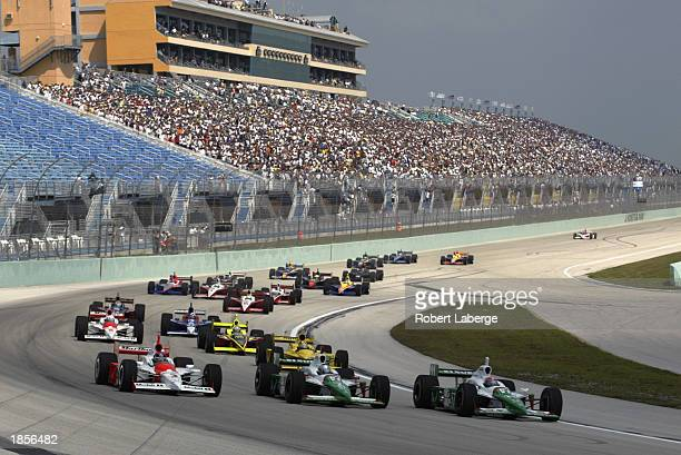 Michael Andretti driver of the Andretti Green Racing Team 7Eleven Honda Dallara and his teammate Tony Kanaan lead the Marlboro Team Penske Toyota...