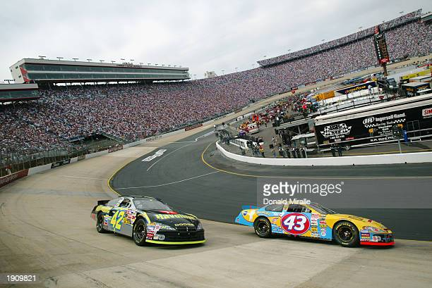 Michael Andretti in the Cheerios Dodge races ahead of Jamie McMurray in the Ganassi Racing Dodge during the NASCAR Winston Cup Food City 500 at...