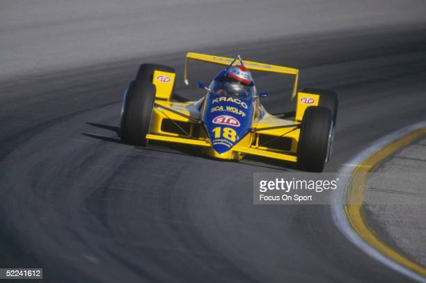 Michael Andretti races around a turn during the Indy 500 at the Indianapolis Motor Speedway circa 1986 in Indianapolis, Indiana.