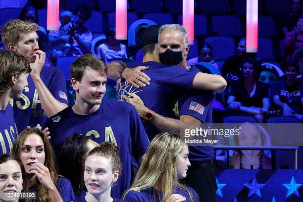 Michael Andrew of the United States and coach Peter Andrew react during Day Eight of the 2021 U.S. Olympic Team Swimming Trials at CHI Health Center...
