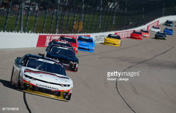 Michael Annett driver of the Northland Oil Chevrolet leads a pack of cars during the NASCAR Xfinity Series Iowa 250 presented by Enogen at Iowa...