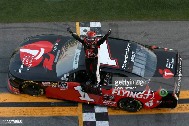 Michael Annett driver of the Pilot Flying J/American Heart Association Chevrolet celebrates after winning the NASCAR Xfinity Series NASCAR Racing...