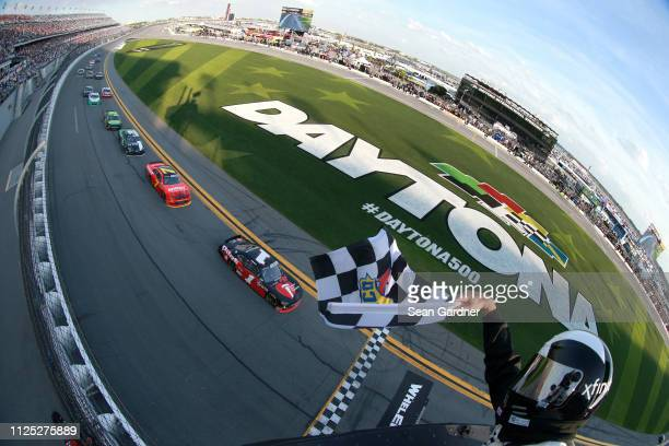 Michael Annett driver of the Pilot Flying J/American Heart Association Chevrolet crosses the finish line to win the NASCAR Xfinity Series NASCAR...