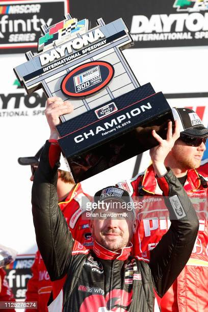 Michael Annett driver of the Pilot Flying J/American Heart Association Chevrolet poses with the trophy in Vicotory Lane after winning the NASCAR...