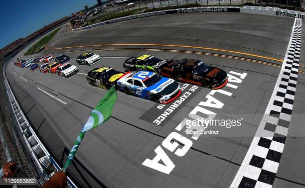 Michael Annett driver of the TMC Transportation Chevrolet leads the field to the green flag during the NASCAR Xfinity Series MoneyLion 300 at...