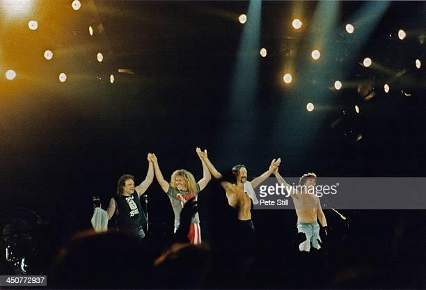 Michael Anthony Alex Van Halen Sammy Hagar and Eddie Van Halen of Van Halen take a final bow after their performance on stage at Wembley Arena on...