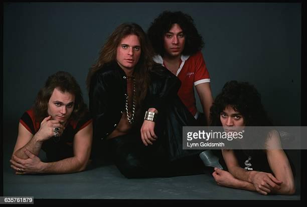 Michael Anthony David Lee Roth Alex Van Halen Eddie Van Halen of the rock group Van Halen pose in a photographer's studio