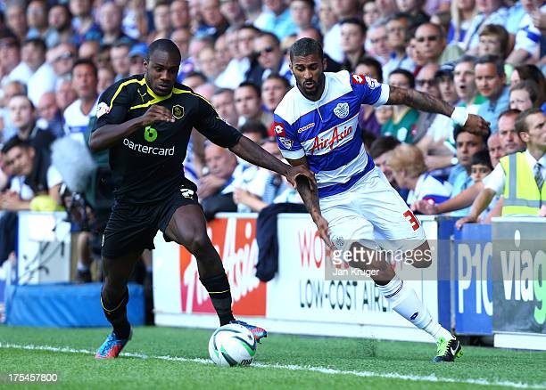 Michael Antonio of Sheffield Wednesday battles with Armand Traore of Queens Park Rangers during the Sky Bet Championship match between Queens Park...