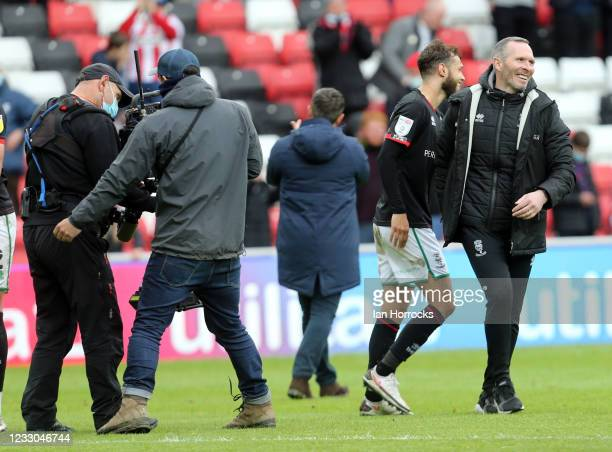 Michael Appleton, Lincoln manager shakes hands with players on the final whistle during the Sky Bet League One Play-off Semi Final 2nd Leg match...