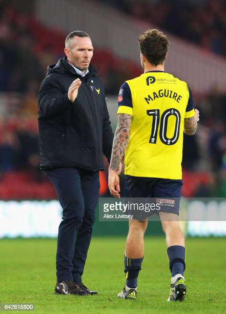 Michael Appleton Manager of Oxford United and Chris Maguire of Oxford United embrace after The Emirates FA Cup Fifth Round match between...