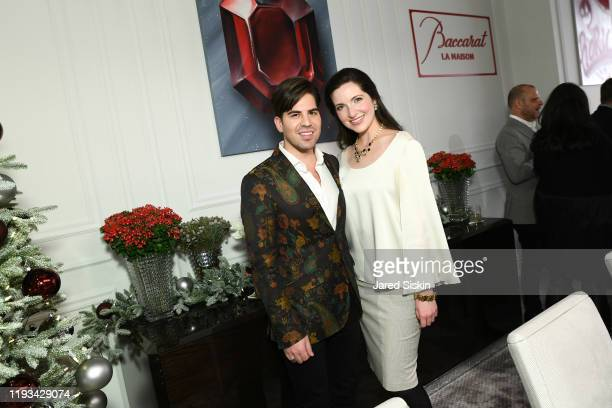 Michael Arguello and Julia Foster attend Roric Tobin's Holiday Dining Room For Luxury Living at Luxury Living Showroom on December 11 2019 in New...