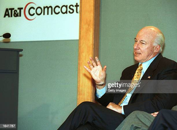 ATT CEO C Michael Armstrong gestures as he responds to a question at a media conference to announce the merger between ATT Broadband with Comcast...