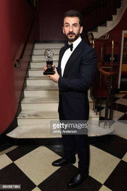 """Michael Aronov, winner of the award for Best Featured Actor in a Play for """"?Oslo"""",? poses in the press room during the 2017 Tony Awards at 3 West..."""