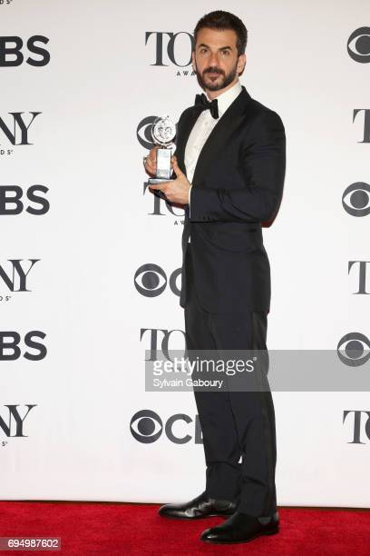 """Michael Aronov, winner of the award for Best Performance by an Actor in a Featured Role in a Play for """"Oslo,"""" poses in the press room during the 2017..."""