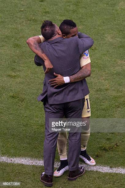 Michael Arroyo of America celebrates with coach Antonio Mohamed after scoring the first goal during a Final second leg match between America and...