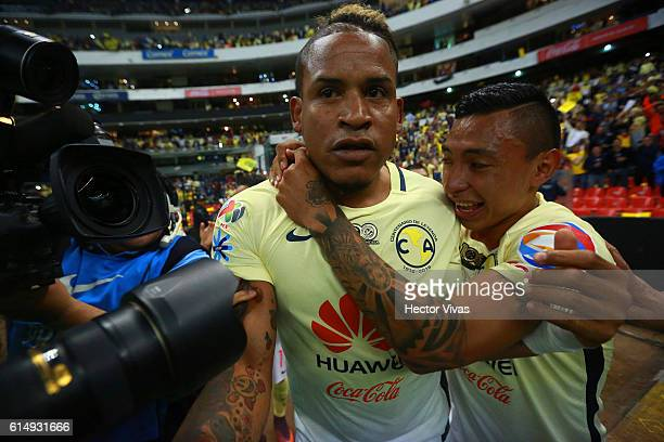Michael Arroyo of America celebrates with teammates after scoring the first goal of his team during the 13th round match between America and Tijuana...