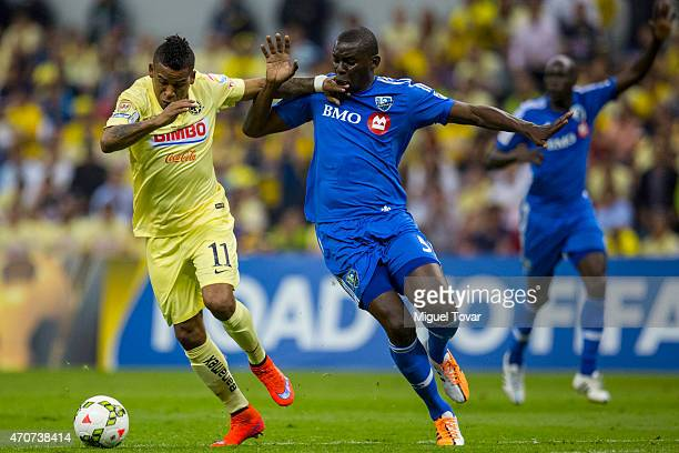 Michael Arroyo of America fights for the ball with Bakary Soumare of Impact during a Championship first leg match between America and Montreal Impact...