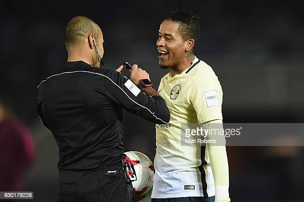 Michael Arroyo of Club America shares a laugh with referee Nawaf Shukralla during the FIFA Club World Cup 3rd place match between Club America and...