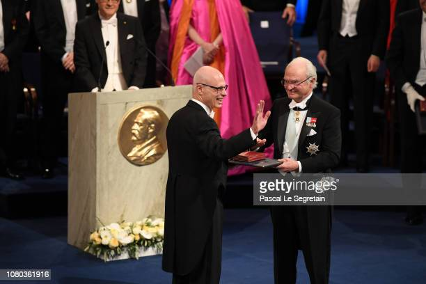 Michael Ashkin receives the Nobel Prize of Physics on behalf of his father Arthur Ashkin from King Carl XVI Gustaf of Sweden during the Nobel Prize...