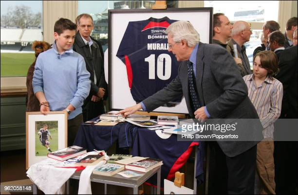 Michael Aspel looks at a collection of modern sporting memorabilia during a recording of Antiques Roadshow in the Long Room at Lord's Cricket Ground...
