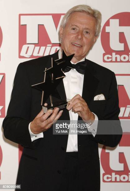 Michael Aspel receives the Best Lifestyle Show award for the Antiques Roadshow during the TV Quick and TV Choice Awards at the Dorchester Hotel in...
