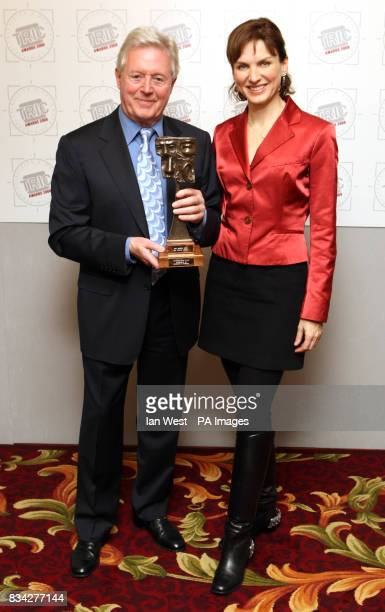 Michael Aspel with the Tric Special Award presented by Fiona Bruce for the Antiques Roadshow during the TRIC Awards held at the Grosvenor Hotel in...
