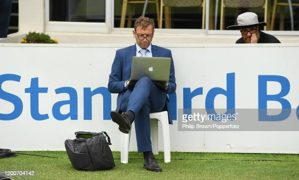 Michael Atherton of Sky Sports and the Times works on a computer before the presentations as photographer Stu Forster looks on during Day Five of the...