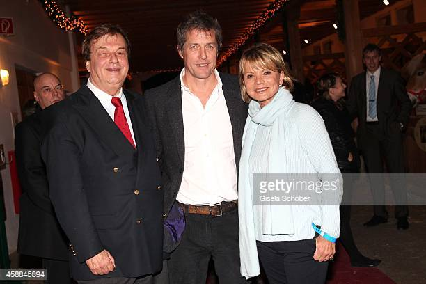 Michael Aufhauser Hugh Grant and Uschi Glas during the Opening of the Gut Aiderbichl Christmas Market on November 11 2014 in Henndorf am Wallersee...