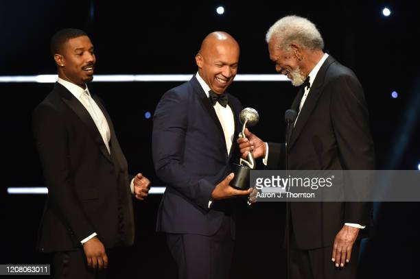Michael B Jordan and Bryan Stevenson accept Outstanding Motion Picture for Just Mercy from Morgan Freeman onstage during the 51st NAACP Image Awards...