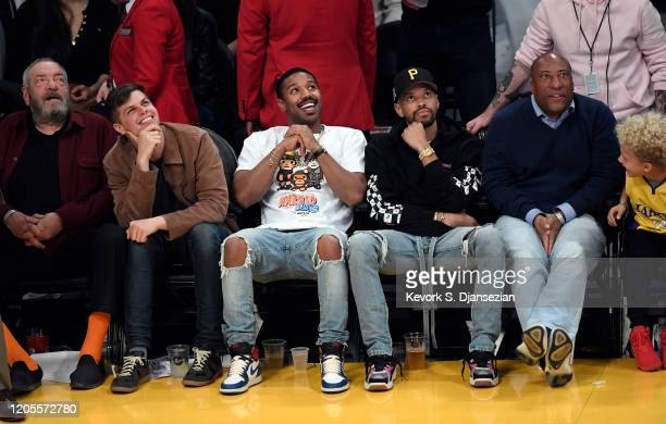 Michael B Jordan and Byron Allen attend Los Angeles Lakers and Milwaukee Bucks basketball game at Staples Center on March 6 2020 in Los Angeles...