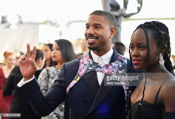 Michael B Jordan and Lupita Nyong'o attend the 25th Annual Screen Actors Guild Awards at The Shrine Auditorium on January 27 2019 in Los Angeles...