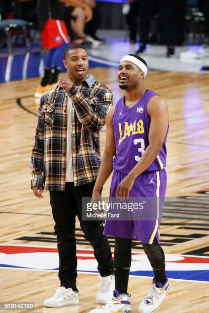 Michael B Jordan and Sterliong Brim talk during the NBA AllStar Celebrity Game presented by Ruffles as a part of 2018 NBA AllStar Weekend at the Los...
